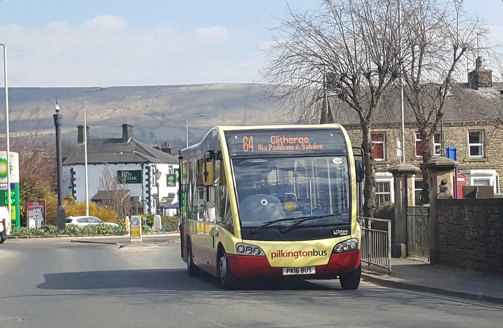 Pilkington Bus Optare Solo SR (PK16 BUS) on Well Terrace in Clitheroe with Pendle Hill in the background