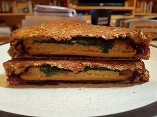 Toasted Sandwich with Tofurky Oven Roasted, spinach, maybe cheese, some sort of red tart jam