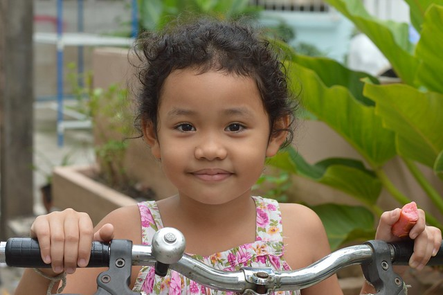 pretty girl on her tricycle