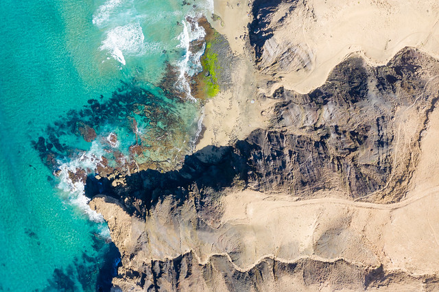 Aerial view of volcanic mountains at the beach Playa del Viejo Reyes on Fuerteventura, Canary Islands