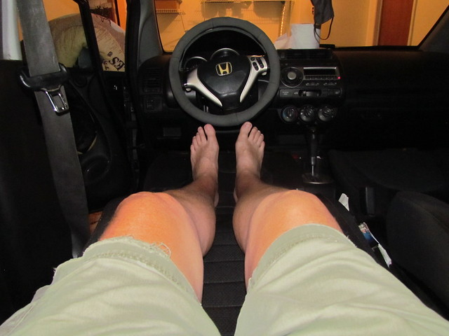 RELAXING IN MY 2007 HONDA FIT SPORT IN MY GARAGE WHILE IT RAINS OUTSIDE.
