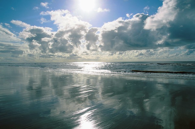 Cloud and Sun reflections on the beach at St Annes, Lancashire