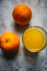 Two oranges and juice from above.
