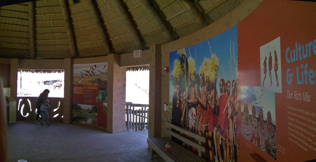 African savannah outside, local villagers on the inside