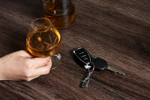 Concept of driving a car after alcohol consumption