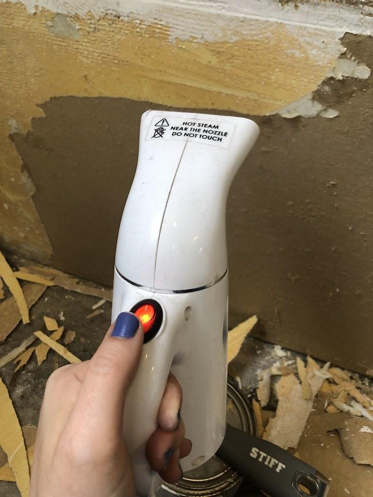 Steaming carpet glue off a wall