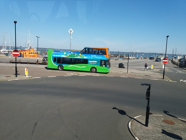 Having completed a route 27 run to Yarmouth, Southern Vectis 1992 GSK 962 (HW52 EPL) turns into the 10:55am Needles Breezer towards Alum Bay