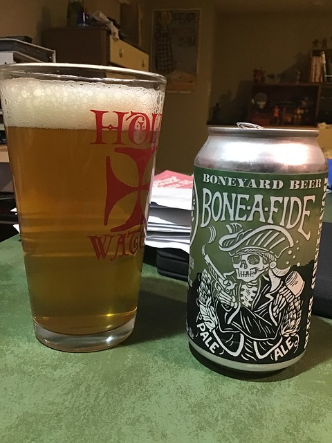 Bonyard Bone-A-Fide pale in glass, next to can.