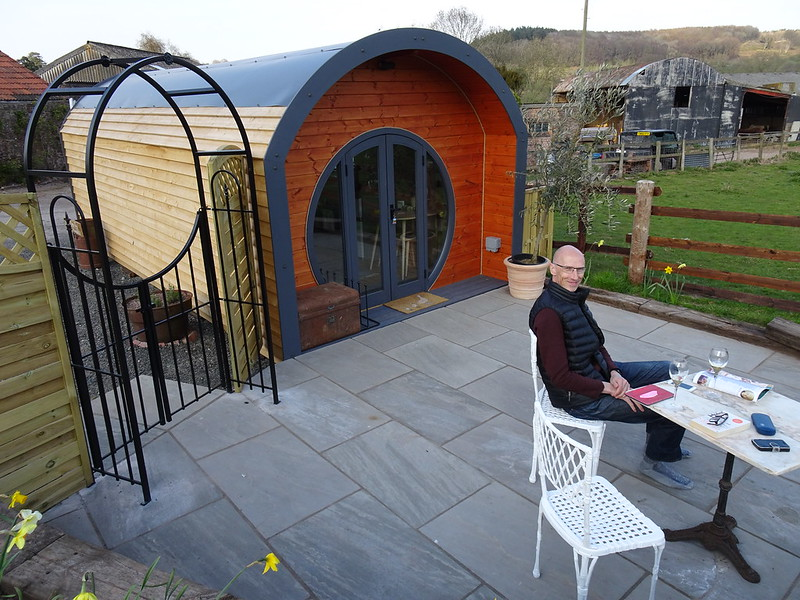 Relaxing on the patio at Abbey Dore Pod