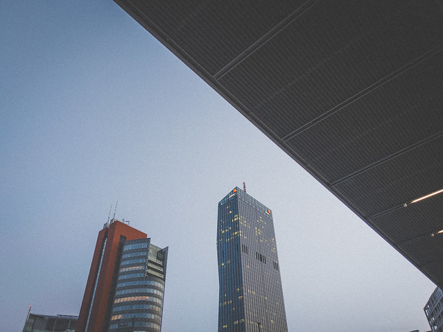 Two tall buildings in a modern city