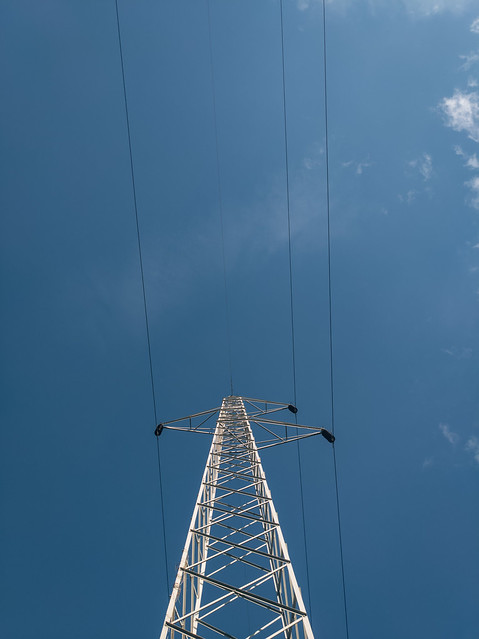 Transmission line with clear blue sky in the background