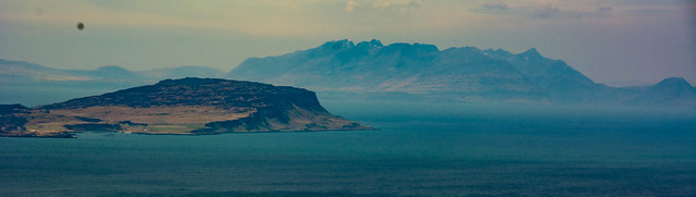 Isle of Eigg with Skye Cuillin behind from B.Hiant