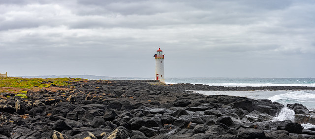 Port Fairy Lighthouse and the basalt rock of Griffiths Island