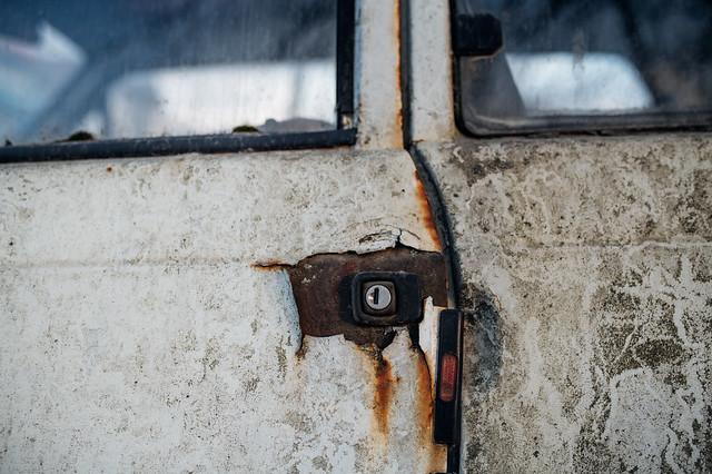 Close-up of a key hole of a rusty abandoned car