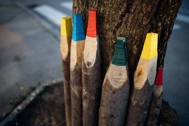 Colorful pencils carved from big tree branches