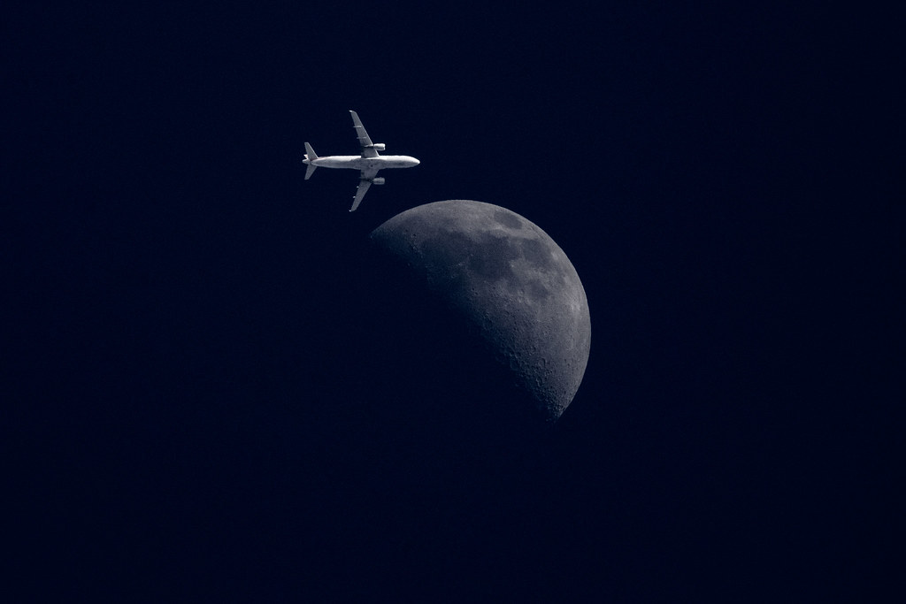 moon and airplane close