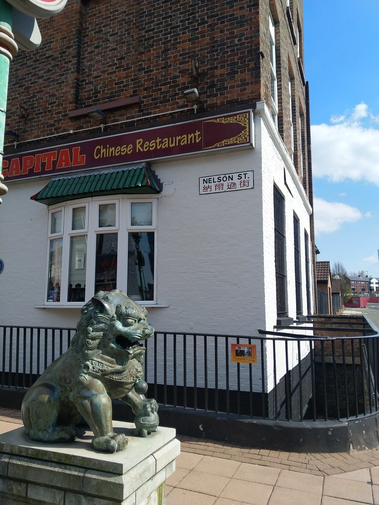 Lion and Chinese street sign, Liverpool