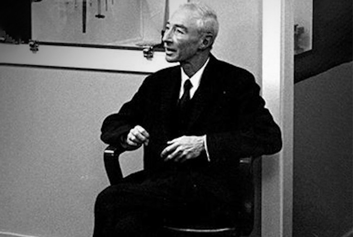 J. Robert Oppenheimer sits in his Director's chair when he returned to Los Alamos for a visit in 1964.
