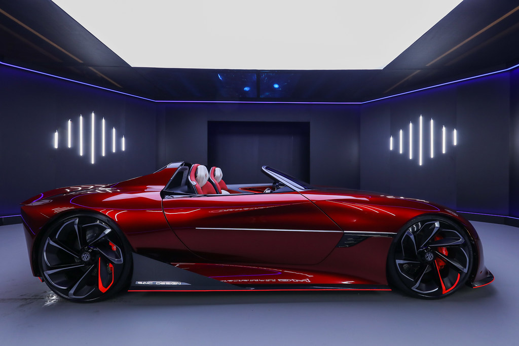 A red sports car Description automatically generated with low confidence
