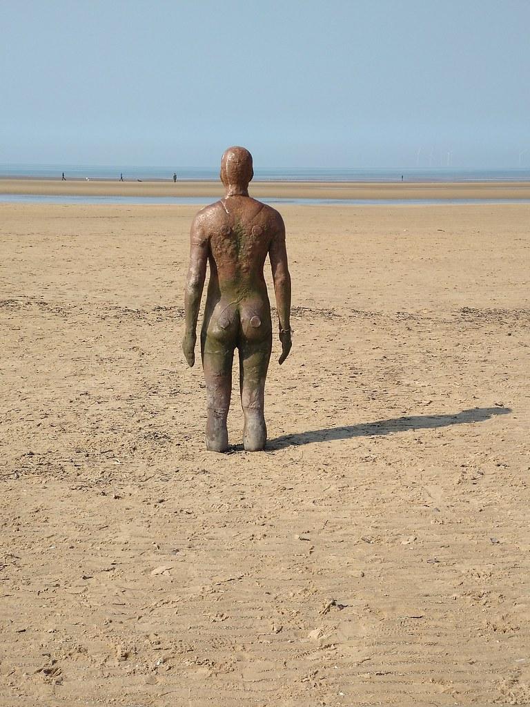 One of the Antony Gormley statues at Crosby Beach