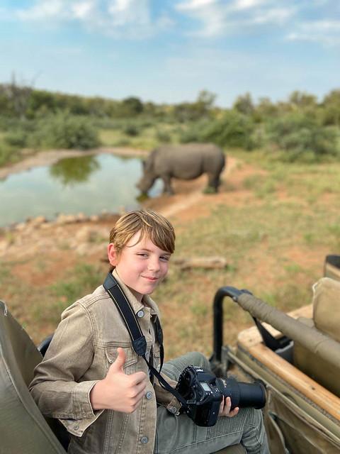 on Safari with camera and white rhino
