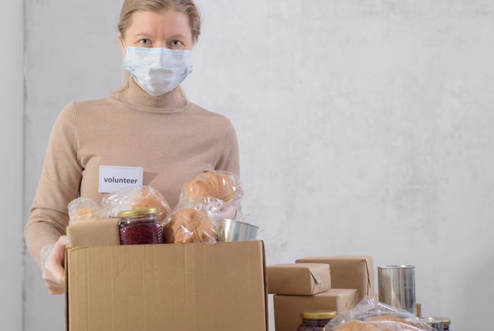 Volunteer holding food donation box