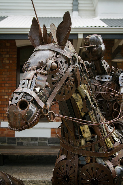 Metal sculpture of a horse and rider.