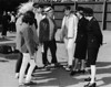 Two female police officers chatting with teenagers at Empire Stadium