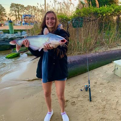 Photo of woman holding large catfish