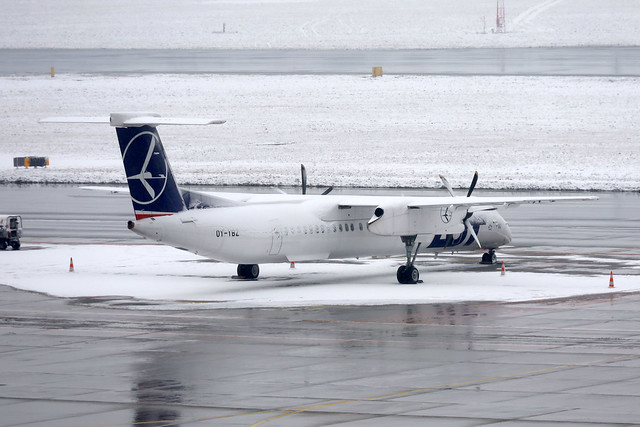 LOT Polish Airlines DHC-8-400 OY-YBZ parked at WAW/EPWA