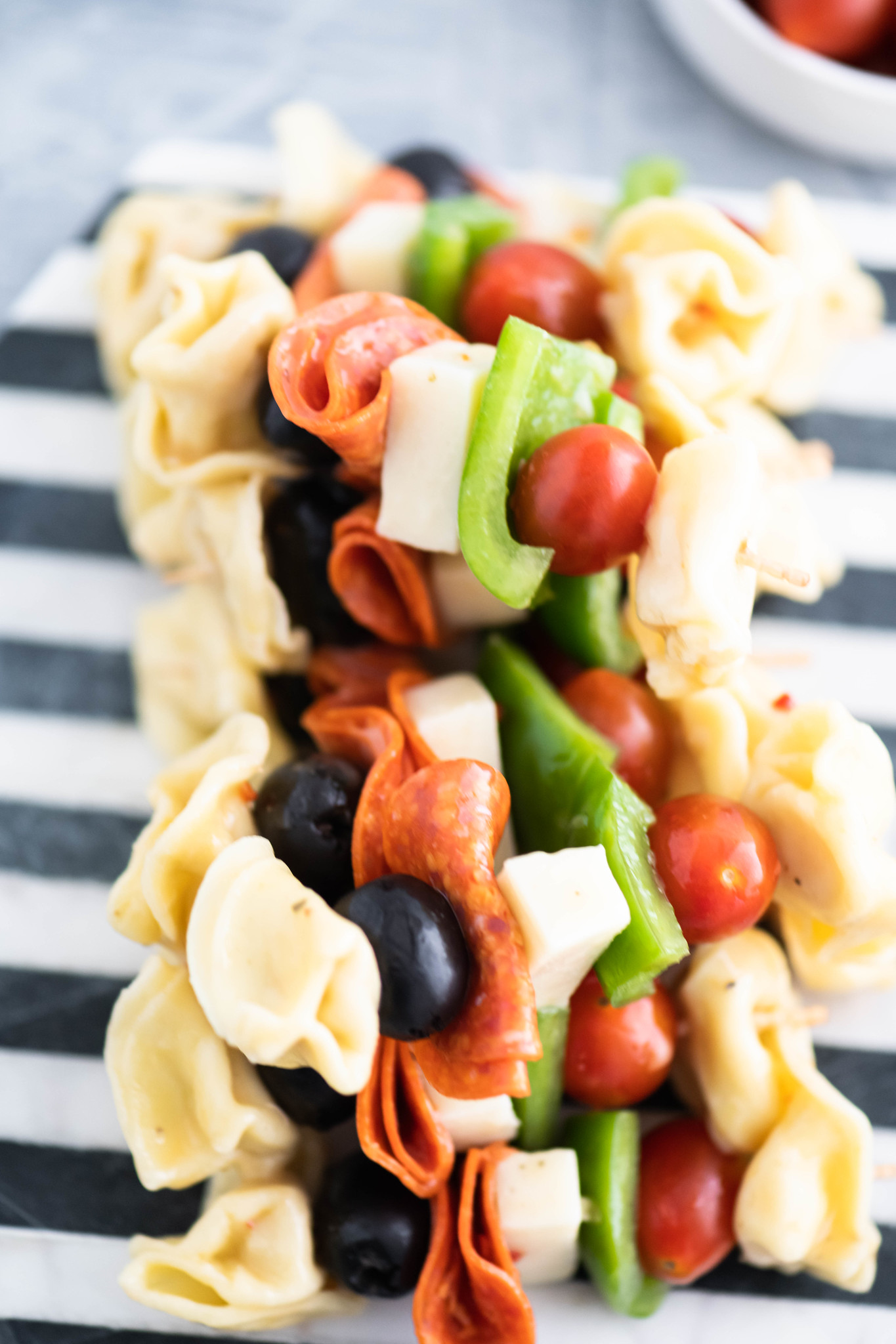 Looking for a fun appetizer or creative lunch box addition? Pasta Salad on a Stick takes all the classic pasta salad ingredients and threads them on a long toothpick for a delicious new spin. Perfect for parties and afternoon snacks alike.