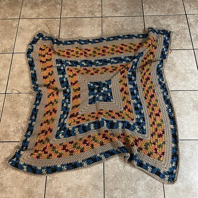 """Christina's """"4 year old picked out this yarn and asked me to make him a blanket from it. It is some of the worst coloured yarn I've ever used, but my gosh he loves it. So I present, one huge granny square blanket aka the worlds ugliest blanket."""""""