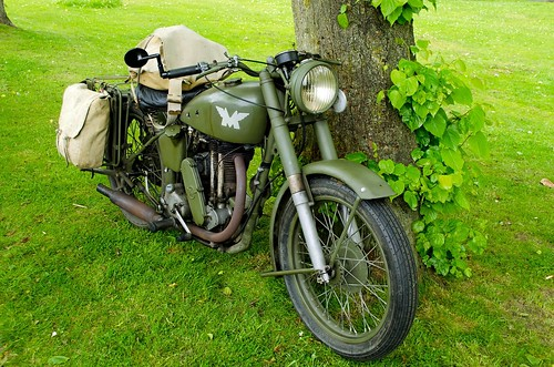 Vintage green motorcycle with saddlebags. From Motorcycle Camping Gear: 10 Must-Have Items
