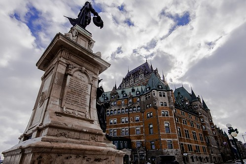 Quebec City statue and Frontenac hotel. From https://live.staticflickr.com/65535/51133244865_e6f587fd49.jpg