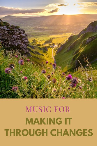 View from the mountain across a gorgeous green landscape, with sun shining in the top right corner, lighting the landscape. From Music for Making it Through Changes