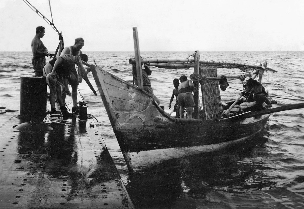 (Explored) Submarine Hr Ms K XV, encounter with a local boat, Indonesia, ca. 1944