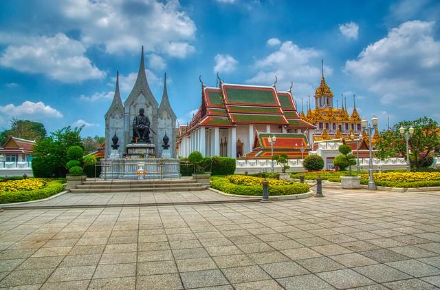 Statue of King Rama III and Wat Ratchanatdaram Worawihan with Loha Prasat on Rattanakosin island (Old Town) in Bangkok, Thailand