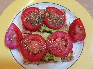 Ryvita with Avocado Horseradish Mash, tomatoes, and garlic and dill salt