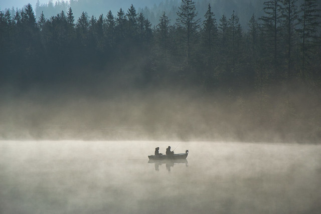 Two fisherman on the Hintersee lake at an early hour