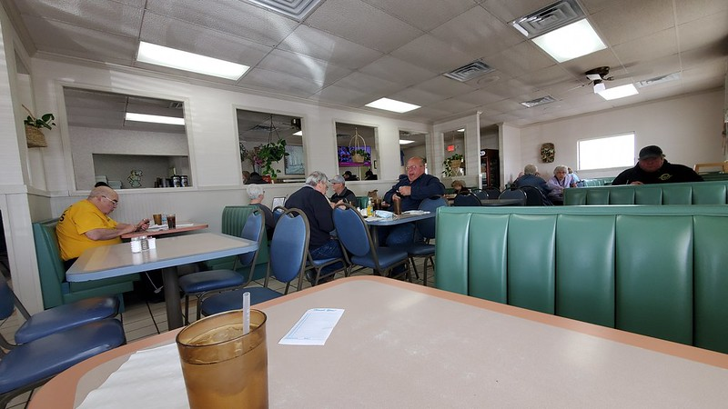 Local farmers enjoy their lunchtime conversation at the Jubilee Cafe in Edwards, Illinois.
