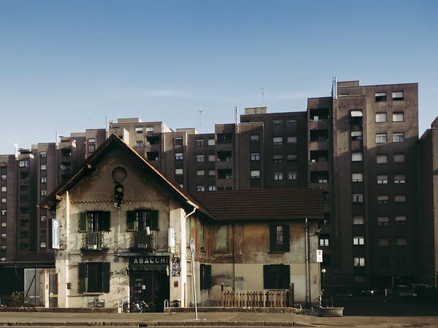 Milan - Buildings looming over old tobacco shop