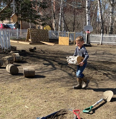 Helpers hauling logs