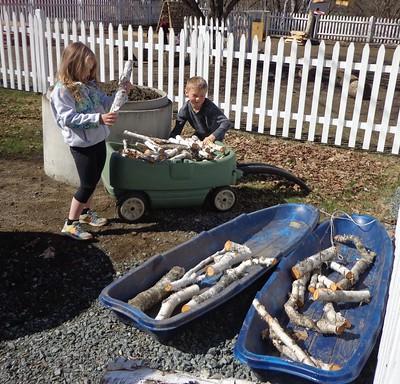 helpers hauling wood