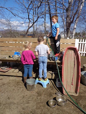 Helpers filling up the water tank