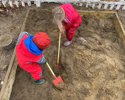 Helping dig out a hole