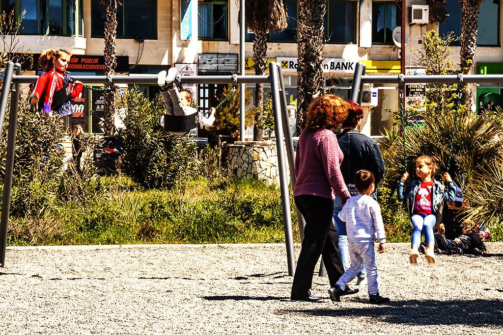 Kids on swings by seaside on 4-25-21--Durres
