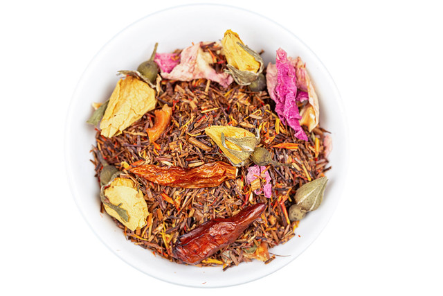Chili tea with yellow and pink rosebuds, top view
