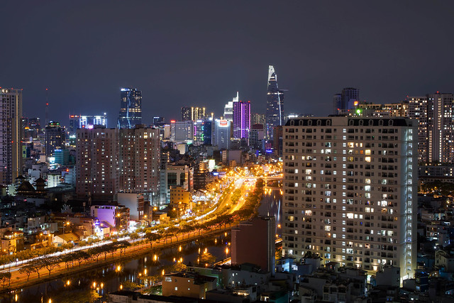 Long Exposure Photo of Ho Chi Minh City Skyline with Bitexco Financial Tower and Saigon River at Night