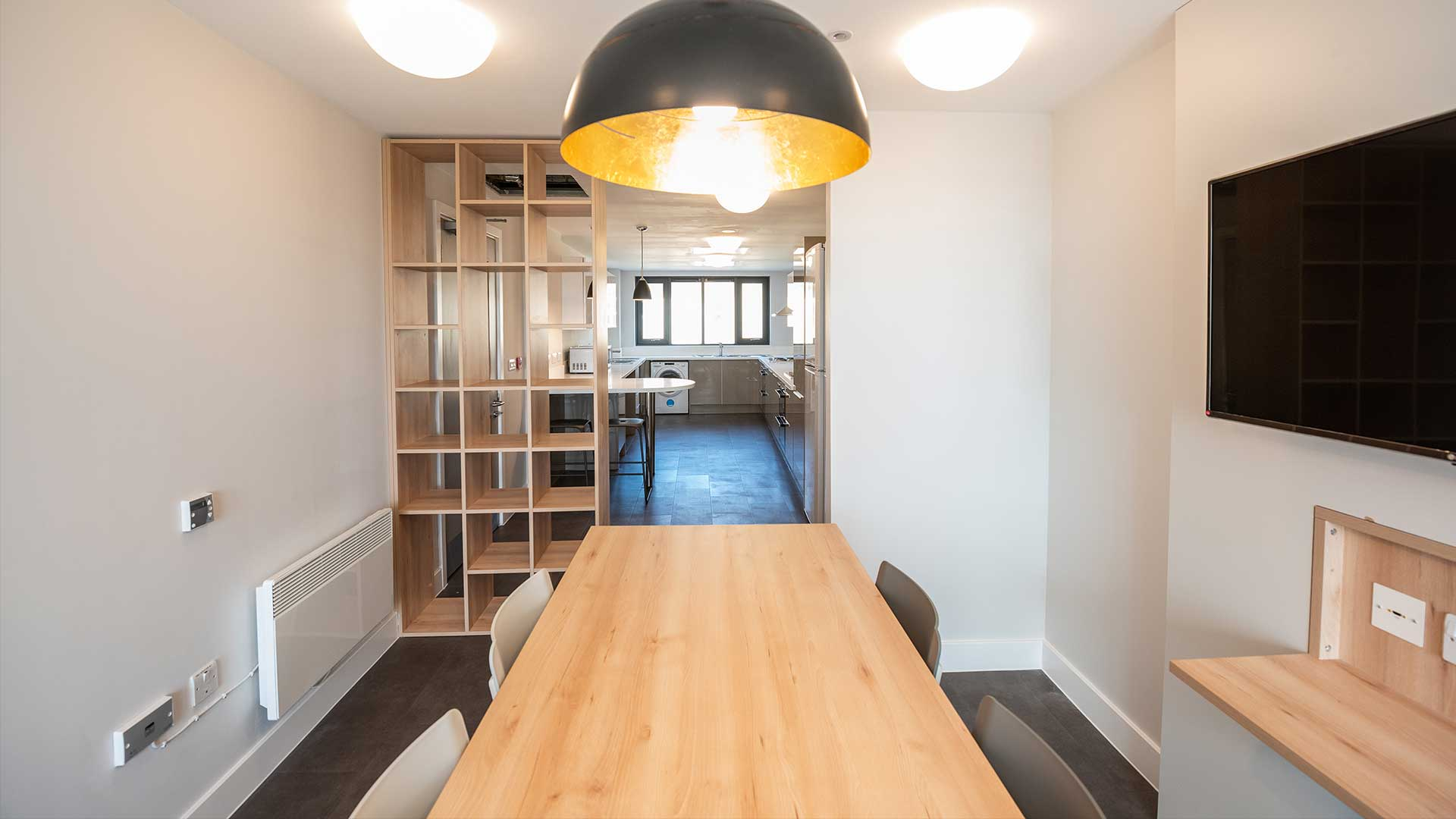 A dining area in a Polden apartment.