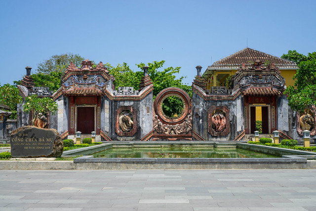 Cong Chua Ba Mu known as Ba Mu Temple Gate with large Pond at blue Sky in the Ancient Town of Hoi An, Vietnam